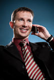 Happy businessman calling by phone Royalty Free Stock Images