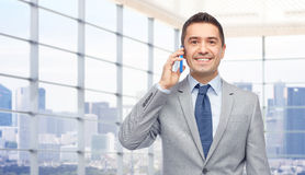 Happy businessman calling on smartphone Royalty Free Stock Image