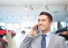 Happy businessman calling on smartphone Royalty Free Stock Photo