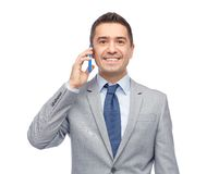 Happy businessman calling on smartphone Stock Image