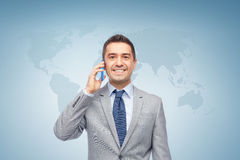 Happy businessman calling on smartphone Stock Photo
