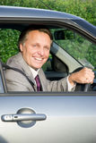Happy businessman in car Royalty Free Stock Photos