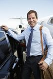 Happy Businessman By Car At Airfield Royalty Free Stock Photos