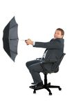 Happy businessman catching wind by umbrella Royalty Free Stock Images