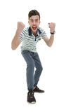 Happy businessman celebrating his success over white background. Happy young business man celebrating his success royalty free stock images