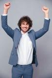 Happy businessman celebrating his success Stock Images