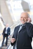 Happy businessman with cellphone Stock Images