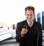 Happy businessman with cellphone Stock Image