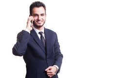 Happy businessman with cellphone smiling at camera Royalty Free Stock Images