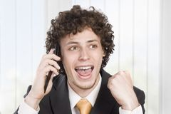 Happy businessman with cellular phone Stock Photos