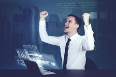 Happy businessman with chart screens. Happy businessman with futuristic business chart screens Royalty Free Stock Photos