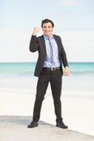 Happy businessman cheering at the beach Royalty Free Stock Images