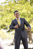 Happy businessman at the city park Stock Images