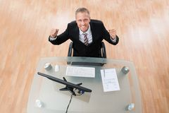 Happy Businessman Clenching His Fist Stock Images