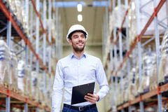 Happy businessman with clipboard at warehouse Stock Photo