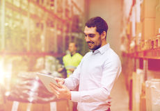 Happy businessman with clipboard at warehouse Royalty Free Stock Photo