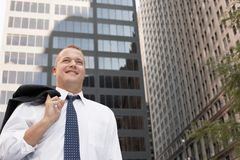 Happy Businessman With Coat Over Shoulder Stock Photography