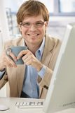 Happy businessman with coffee Stock Photography