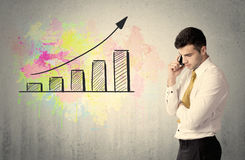 Happy businessman with colorful chart Stock Photos