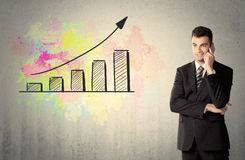 Happy businessman with colorful chart Stock Photo