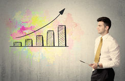 Happy businessman with colorful chart Royalty Free Stock Image