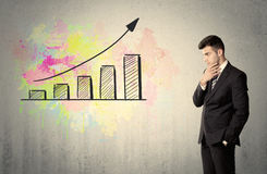 Happy businessman with colorful chart Royalty Free Stock Photo