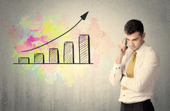 Happy businessman with colorful chart Stock Image