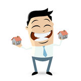 Happy businessman comparing houses Stock Photography