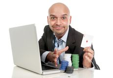 Happy businessman on computer making lots of money internet gambling addict Royalty Free Stock Photo