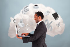 Happy businessman connecting to cloud computing Royalty Free Stock Image