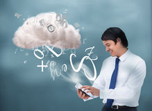 Happy businessman connecting to cloud computing Royalty Free Stock Photos