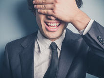 Happy businessman covering his face Royalty Free Stock Photos