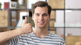 Happy businessman or creative male Thumb Up. High quality Stock Photography