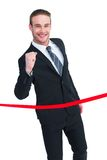 Happy businessman crossing the finish line Stock Photos
