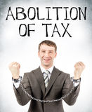 Happy businessman in cuffs. With abolition of tax on grey wall background Royalty Free Stock Photography