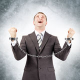 Happy businessman in cuffs Royalty Free Stock Photo