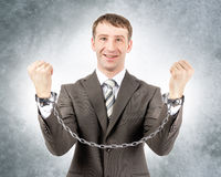 Happy businessman in cuffs Royalty Free Stock Image