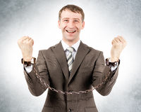Happy businessman in cuffs Stock Photography