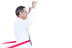Happy businessman cutting red ribbon Stock Photography