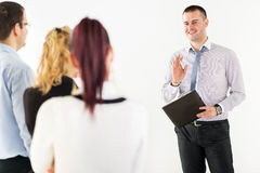 Happy Businessman Demonstrating his Project Stock Images