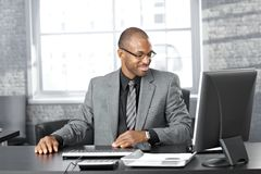 Happy businessman at desk Royalty Free Stock Images