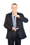 Happy businessman displaying invisible product Royalty Free Stock Photos