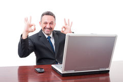 Happy businessman doing double ok sign Stock Photography