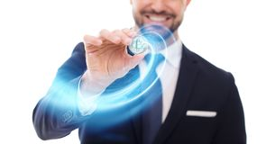 Happy businessman drawing blue glowing technology spiral by bitc. Oin coin on white Stock Photography