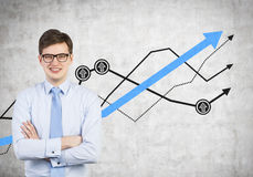 Happy businessman and drawing profit on wall. Young businessman and drawing profit on wall Stock Photo