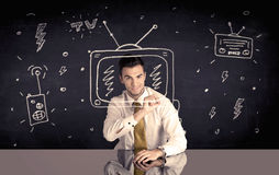 Happy businessman drawing tv and radio Royalty Free Stock Photography