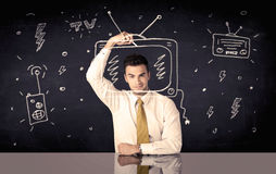 Happy businessman drawing tv and radio Royalty Free Stock Photo