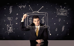 Happy businessman drawing tv and radio Royalty Free Stock Images