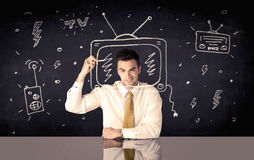 Happy businessman drawing tv and radio Stock Images