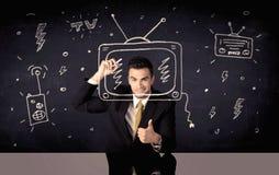 Happy businessman drawing tv and radio Stock Image
